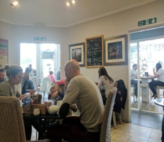 people sitting in a cafe
